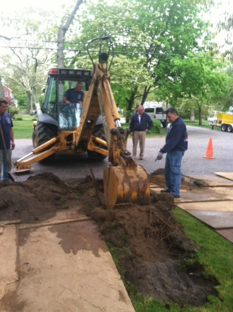 Trenching with backhoe